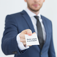 Young financial advisor giving business card
